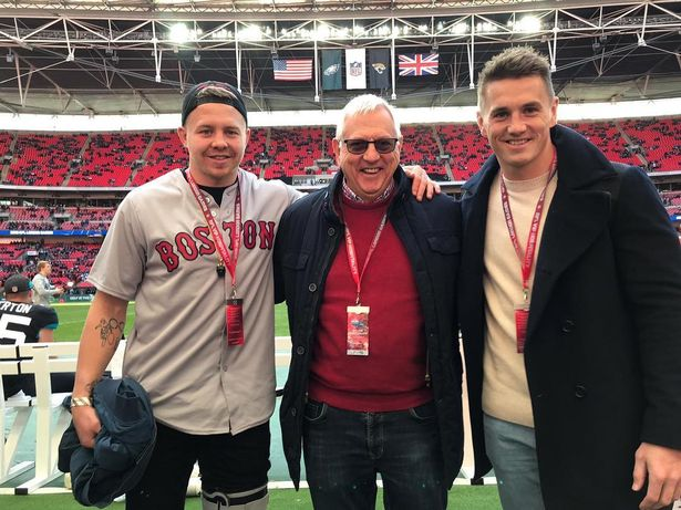 James and Jonathan Davies with their dad at an NFL game at Wembley