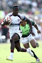 Carlin Isles scores a try against South Africa in the Cup quarter final match during the Emirates Dubai Rugby Sevens - HSBC World Rugby Sevens Series in 2015 in Dubai.