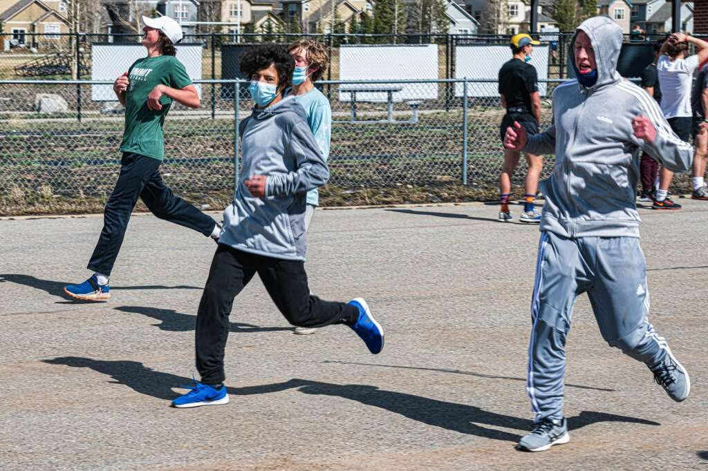 Charlie Chabot, from left, Gabe Kubek and Dirk Bosgraaf run at Summit High School track and field practice at Summit High School in Breckenridge on Wednesday, May 5. | Photo by Joel Wexler / Rocky Mountain.Photography