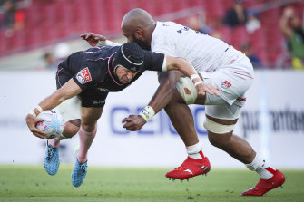 Matt Giteau is tackled by Apisai Naikatini of Old Glory DC in the MLR.