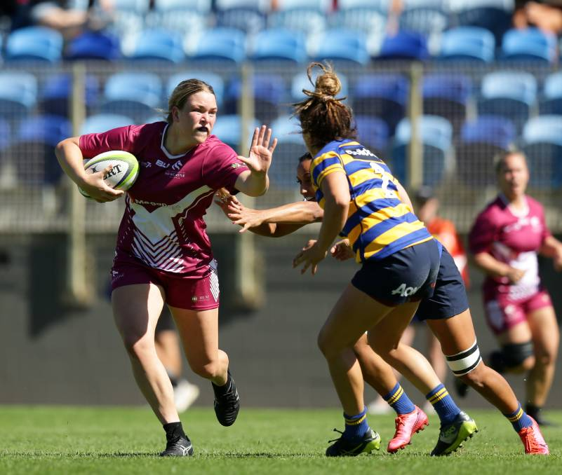 POTENTIAL: Kaitlan Leaney hits the ball up against Sydney University. Picture: Jonathan Carroll