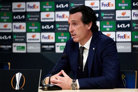 villareal's head coach unai emery sitting at a desk during a uefa europa league press conference