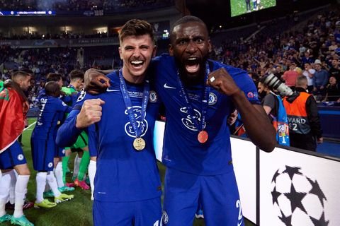 chelsea players mason mount and antonio rudiger smile as they show off their uefa champions league winners' medals