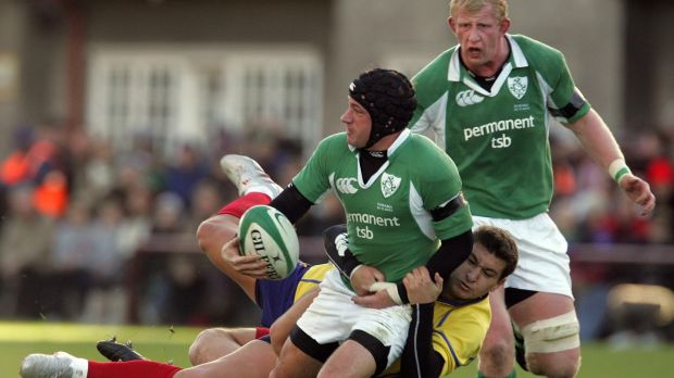 David Humphreys of Ireland is tackled by Ionut Dimofte and Petrisar Toderasc of Romania during an international match at Lansdowne Road in November 2005. Photograph: Lorraine O'Sullivan/Inpho