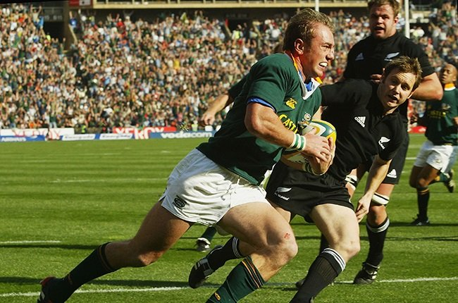 Marius Joubert on his way to scoring the first of his three tries against the All Blacks in 2004.